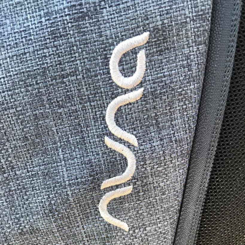 Image shows the fine grey pattern and Nuna logo on the stroller.