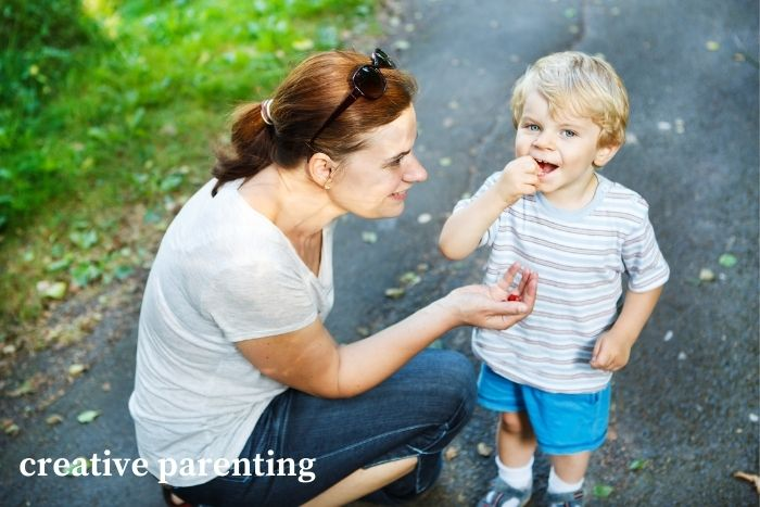 how to discipline a toddler: mom talking to son
