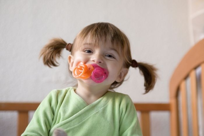 girl with pacifier